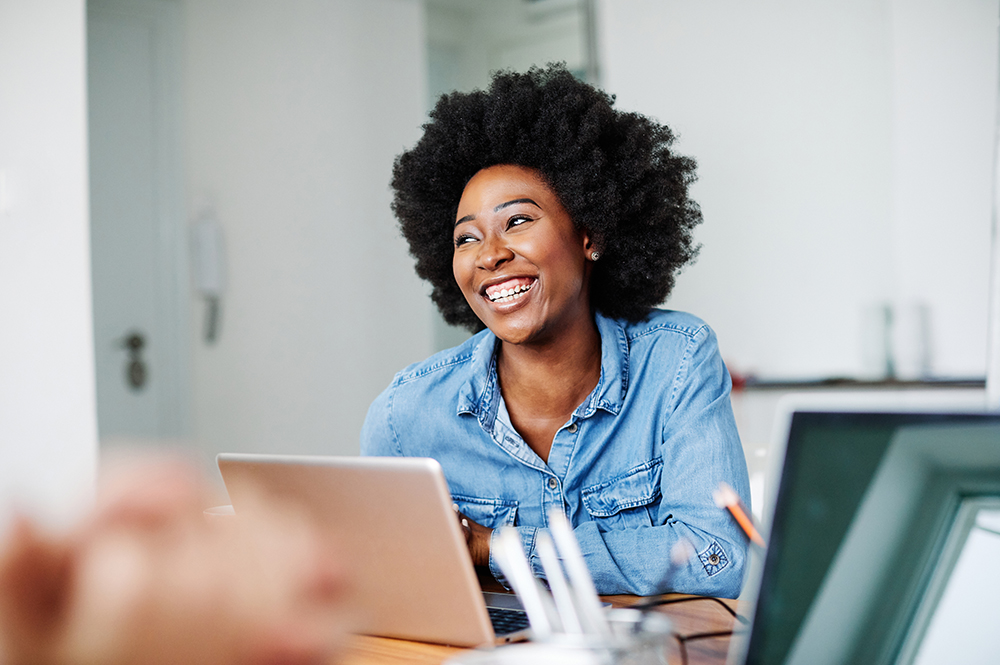 portrait young african american girl woman smiling office classroom